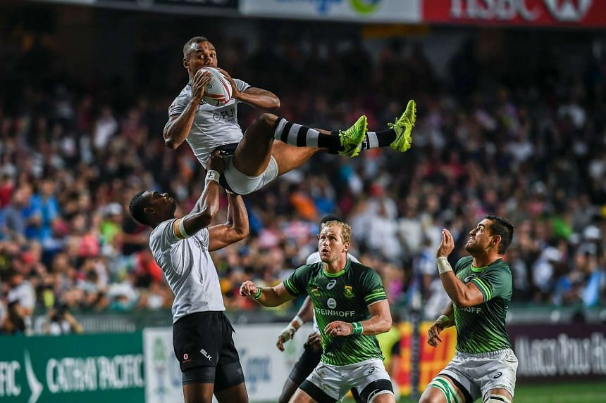 Kalione Nasoko (left) of Fiji lifts his teammate Osea Kolinisau during the Cup Final against South Africa at the Hong Kong Rugby Sevens Tournament on April 9.