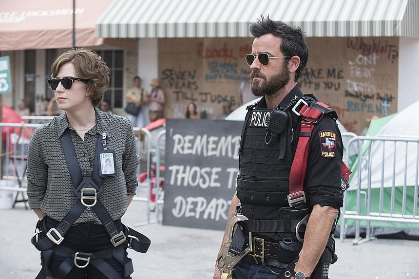 Carrie Coon as Nora Durst and Justin Theroux as Kevin Garvey in the third and final season of HBO series The Leftovers.
