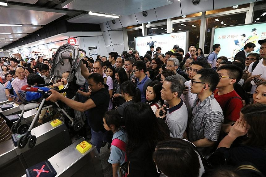 Passengers waiting at the Kwun Tong station after MTR services were disrupted on Monday.