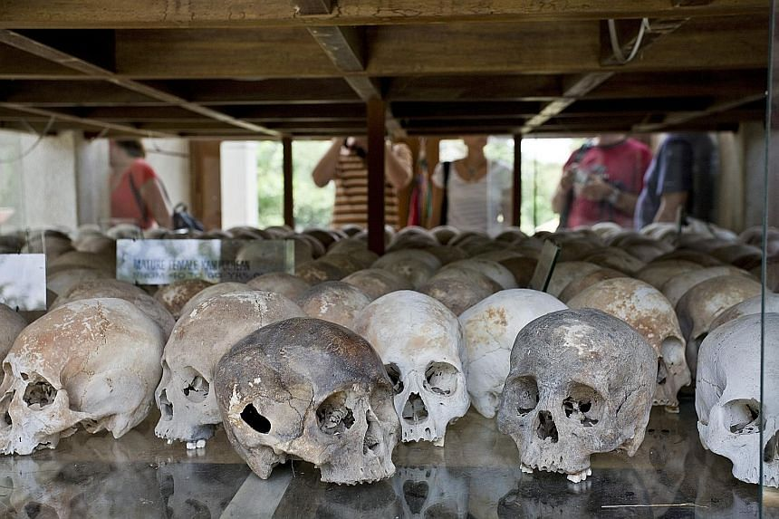 Skulls of victims of the Khmer Rouge at the Choeung Ek memorial in Phnom Penh. At least 1.7 million Cambodians died from 1975 to 1979 during the rule of the Khmer Rouge.