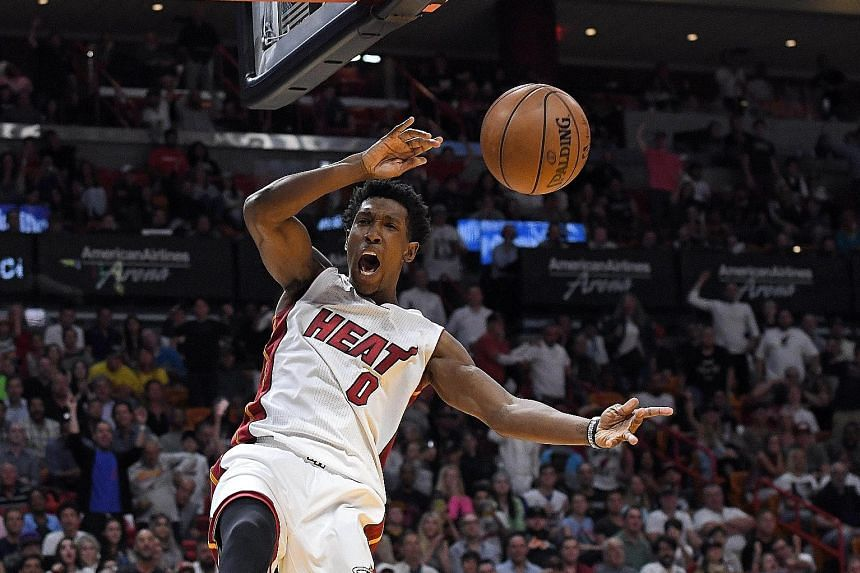 Miami Heat's Josh Richardson dunks during the 124-121 victory against the Cleveland Cavaliers at American Airlines Arena. Richardson, a second-year guard, has taken on much of the burden in the prolonged absence of starting guard Dion Waiters, who ha