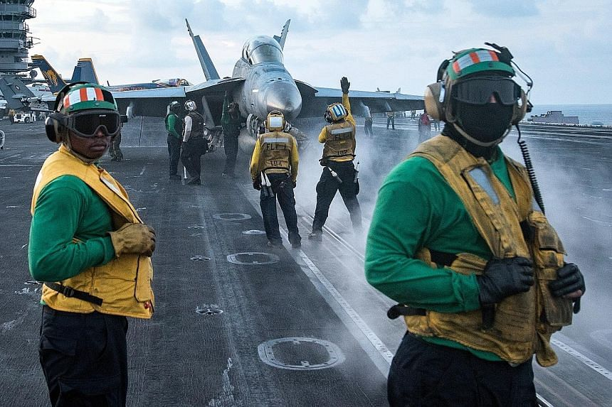US sailors conducting flight operations on the aircraft carrier USS Carl Vinson in the South China Sea last Saturday. The ship's deployment to the waters off the Korean peninsula has raised tensions across East Asia.