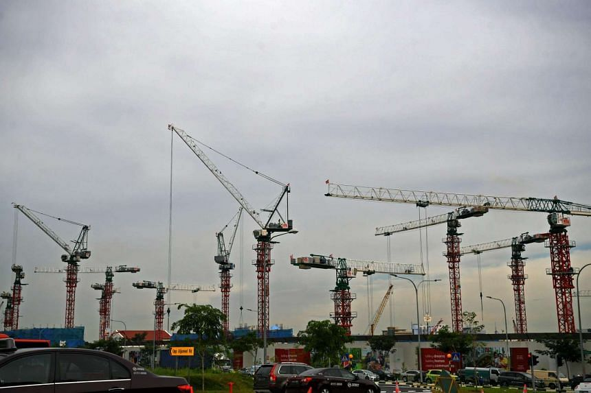 Construction cranes at the former Bidadari cemetery on April 3, 2017. The area will be transformed into the Bidadari housing estate.