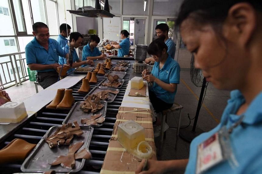 Workers on a production line at the Huajian shoe factory in Dongguan, Guangdong province, on Sept 14, 2016.