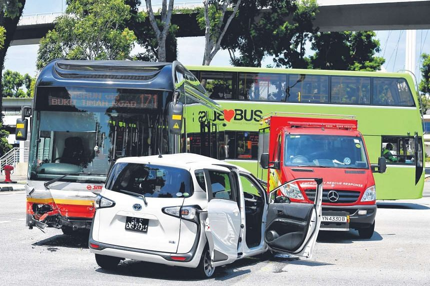 The SMRT bus collided with the Uber car, a white Toyota Sienta, at the junction of Bayfront Avenue and Raffles Avenue at about 2pm yesterday.