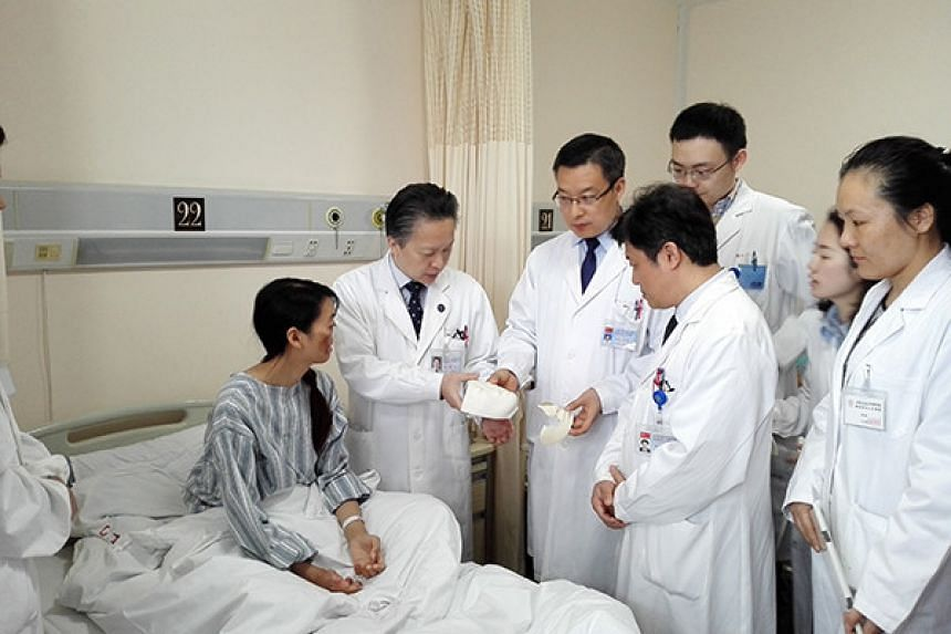 Jin Qi, 27, will have her lower face reconstructed over six months after living without a nose and lips for 25 years.