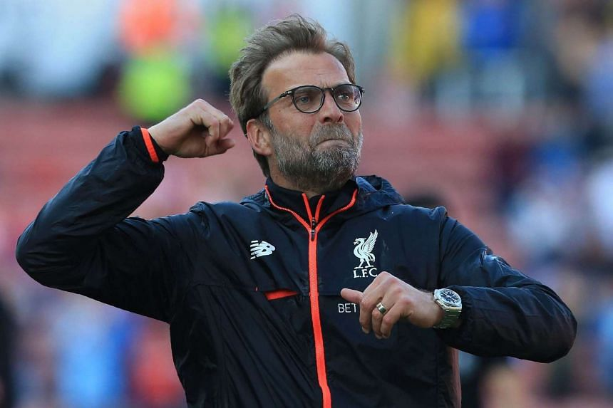 Liverpool's German manager Jurgen Klopp reacts following the English Premier League football match between Stoke City and Liverpool at the Bet365 Stadium in Stoke-on-Trent, central England on April 8, 2017.