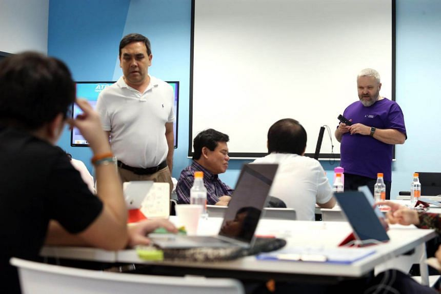 Mr David Woodbridge (right), at a workshop to train visually-impaired participants on the built-in assistive technology features on Apple devices, on April 6, 2017.