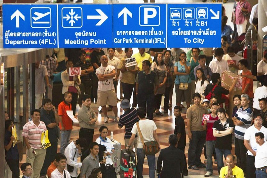 The would-be travellers had paid for cheap holidays to Japan, but found that no plane had been chartered to take them there when they got to Suvarnabhumi airport (above).