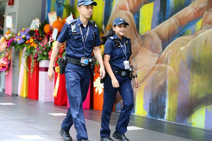 File photo of police officers on patrol. As part of the show, Home Team officers from across 10 agencies such as the Singapore Police Force and the Immigration and Checkpoints Authority will march alongside volunteers and students under the National