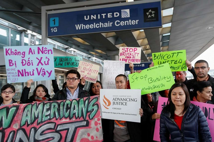 Community members protesting the treatment of Dr David Dao, who was forcibly removed from a United Airlines flight by the Chicago Aviation Police, at O'Hare International Airport in  Illinois, United States, on April 11, 2017.