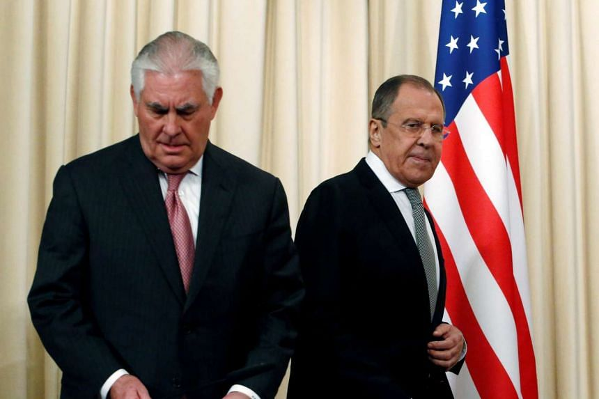 Russian Foreign Minister Sergei Lavrov and US Secretary of State Rex Tillerson arrive for a news conference following their talks.