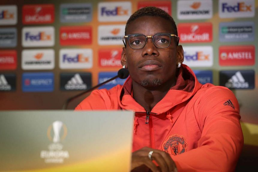 Manchester's French midfielder Paul Pogba takes part in a press conference on April 12, 2017.