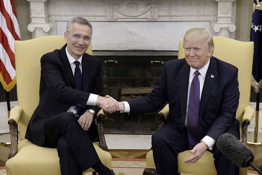 Trump shakes hands with Nato Secretary General Jens Stoltenberg (left) following a meeting at the White House.