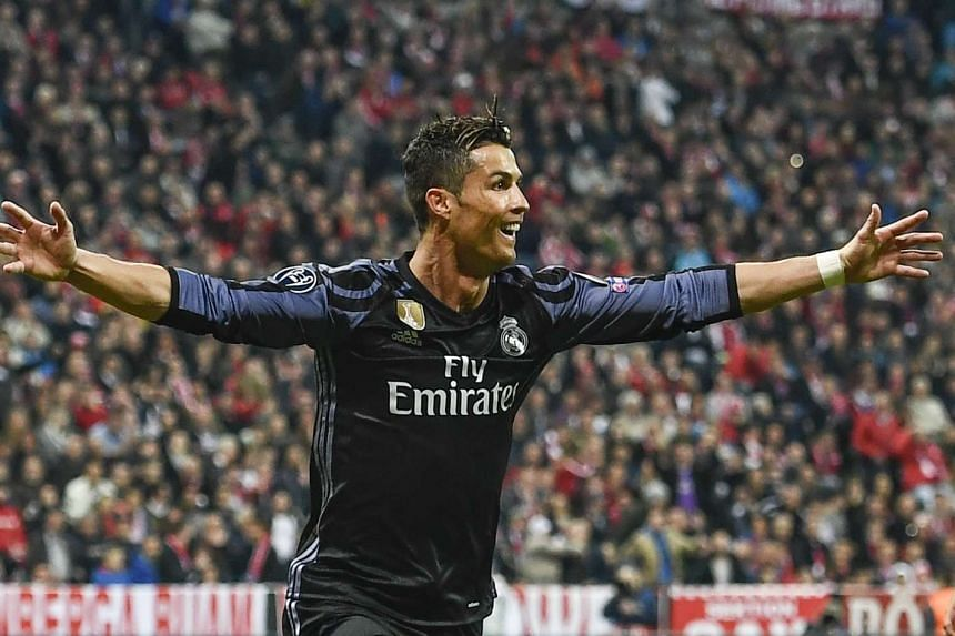 Real Madrid's Cristiano Ronaldo celebrates after scoring the 2-1 lead.