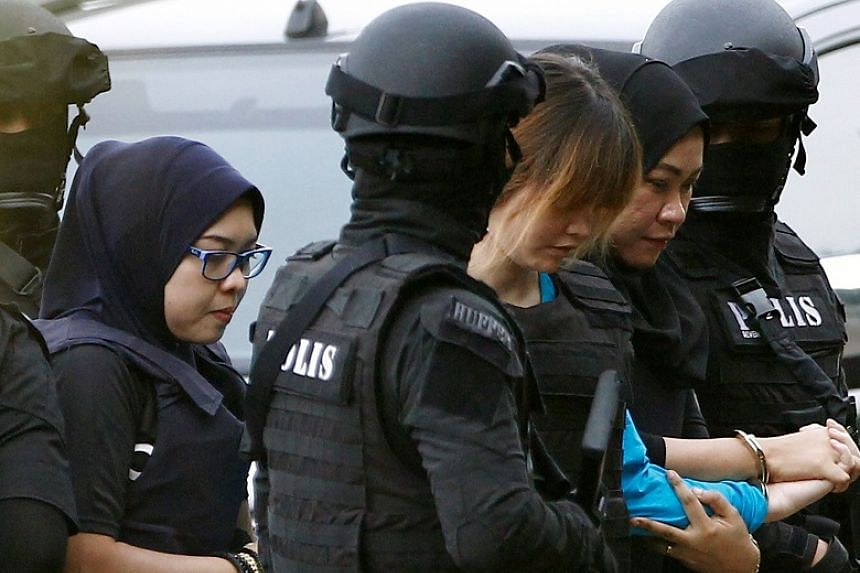 Vietnamese Doan Thi Huong, who was charged with the murder of Kim Jong Nam, is escorted by police as she arrives at a Sepang court, in Malaysia on April 13, 2017.