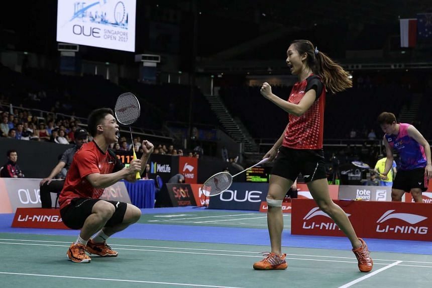 Singapore's Terry Hee and Tan Wei Han react after winning a point.