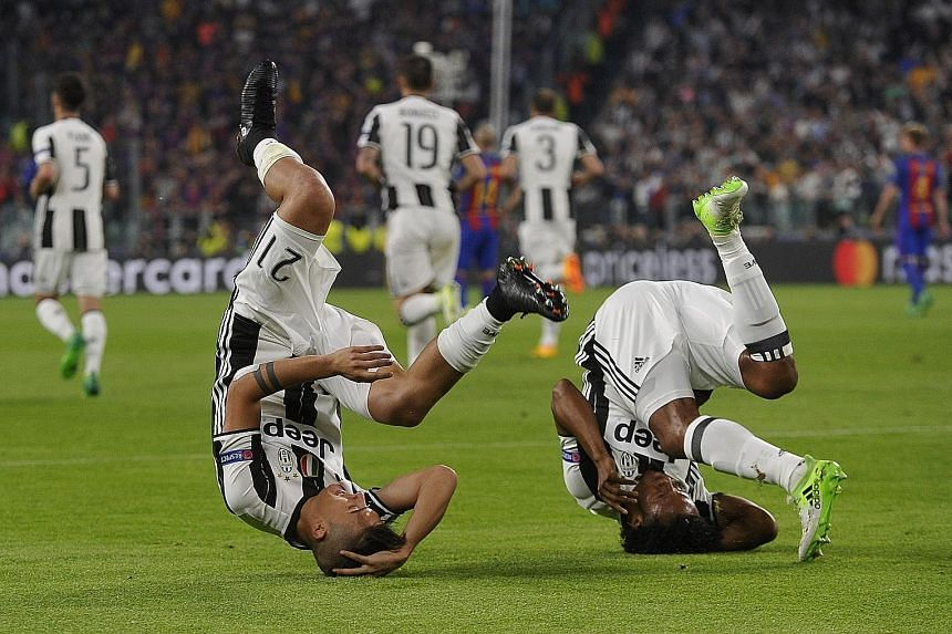 Juventus forward Paulo Dybala (No. 21) celebrating his 7th-minute opener with winger Juan Cuadrado. Dybala capped off a stellar night with a brace against Barcelona, leaving the LaLiga giants teetering on the brink of a Champions League quarter-final