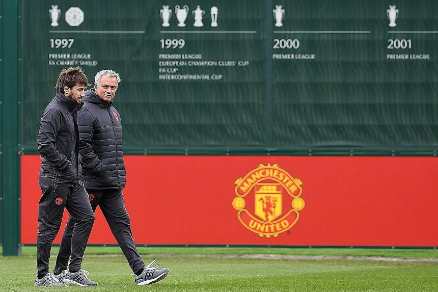 Manchester United manager Jose Mourinho (right) plotting his side's tactics ahead of their Europa League quarter-final against Anderlecht. The Europa League winners will be guaranteed a Champions League berth.