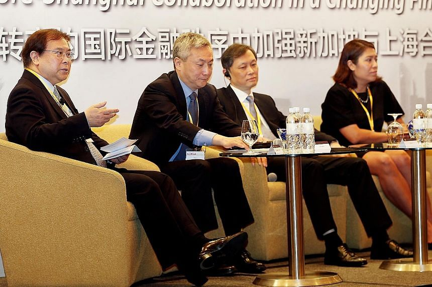 OCBC chief executive Samuel Tsien (far left) addressing the forum. With him are (from left) Mr Liu Xinyi, Bank of Shanghai chairman Jin Yu, and Ms Gopi Mirchandani.