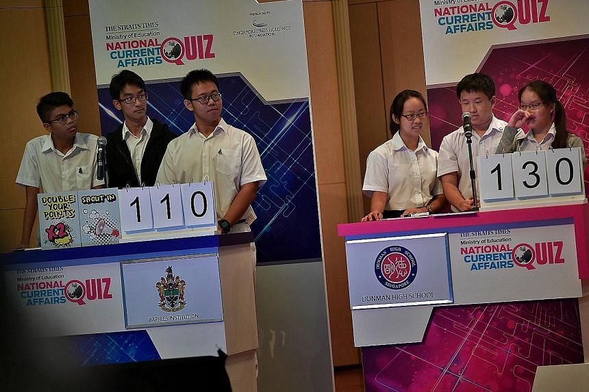 (From left) Raffles Institution's Team A comprising Danial Asyniaf, 17; Nelson Ooi, 16; and Jared Foong, 17; and the winning Dunman High School team comprising Joy See, 17; Ryan Lim, 16; and Sheena Lim, 16. St Andrews Junior College also fielded a te