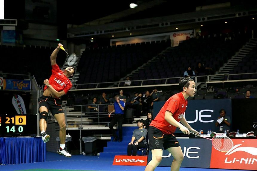 Reigning Olympic badminton mixed doubles champions Tontowi Ahmad (left) and Liliyana Natsir in action in the first round of the OUE Singapore Open at the Indoor Stadium on April 11, 2017.