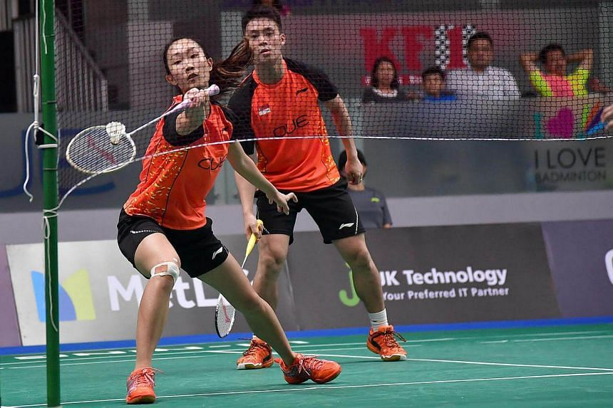 Singapore's Tan Wei Han with Terry Hee Yong Kai in action against Indonesia's mixed double pair, Ronald Ronald and Melati Daeva Oktavianti, at the Opening day of the OUE Singapore Open on April 11, 2017.