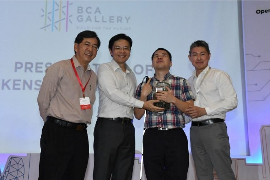 (From left) CEO of BCA, Dr John Keung, Minister Lawrence Wong and SAVH representatives.