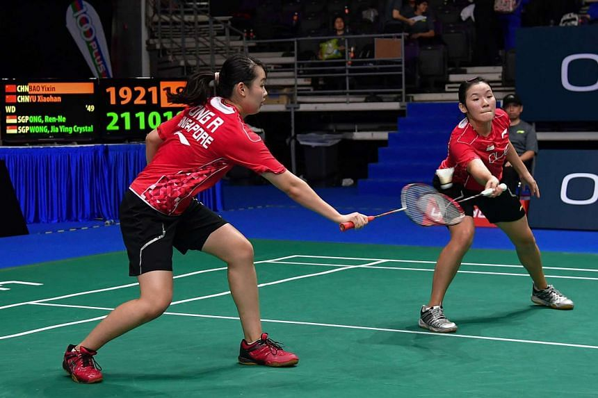(From left) Ong Ren Ne and Crystal Wong Jia Ying playing against China's Bao Yixin and Yu Xiaohan (not pictured) at the opening day of the OUE Singapore Open, on April 11, 2017.
