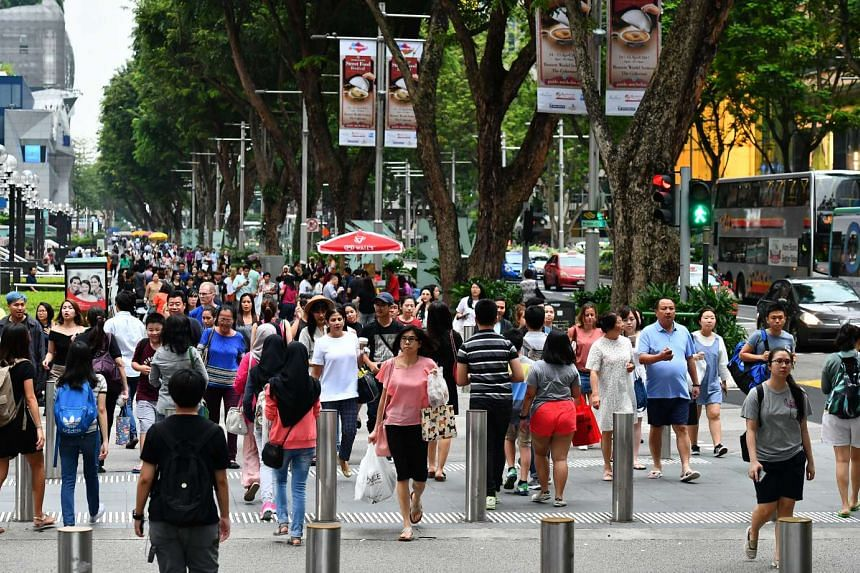 Pedestrians crossing at the junction of Orchard Link and Orchard Road, on April 13, 2017.