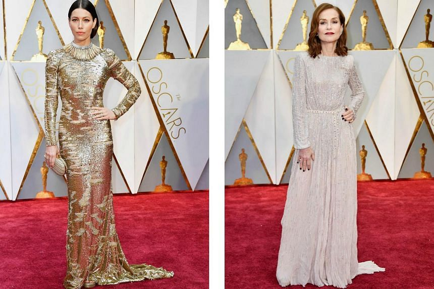 Actresses Jessica Biel (left) in Kaufmanfranco and Isabelle Huppert (right) in Armani Prive at February's Oscars ceremony in California.
