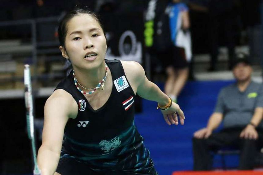 Above: Defending women's singles champion Ratchanok Intanon making an early first-round exit at the Singapore Open, with a 8-21, 18-21 loss to Japan's Sayaka Sato.