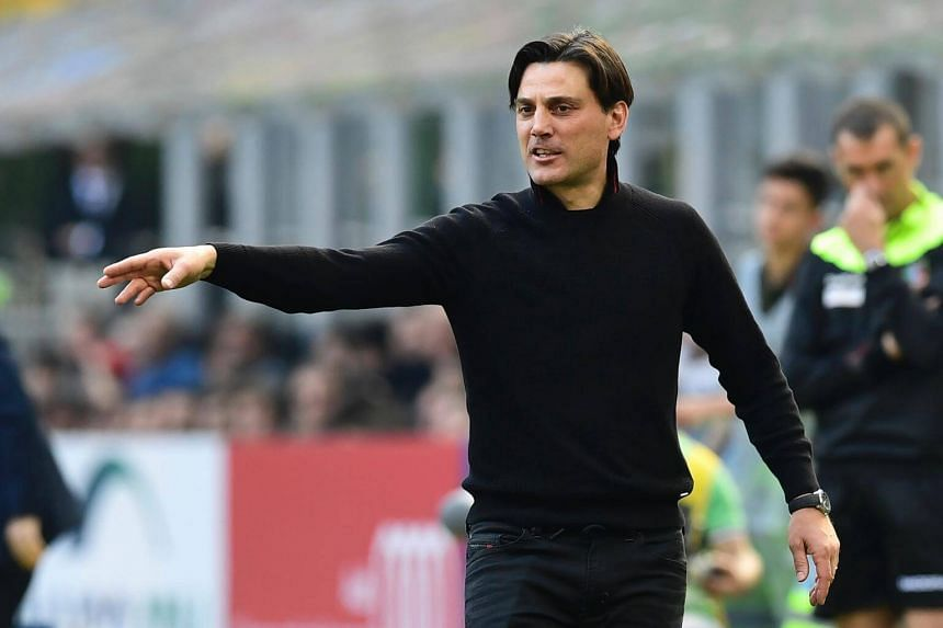 AC Milan's Italian coach Vincenzo Montella gestures during the team's Italian Serie A football match against Palermo on April 9, 2017.