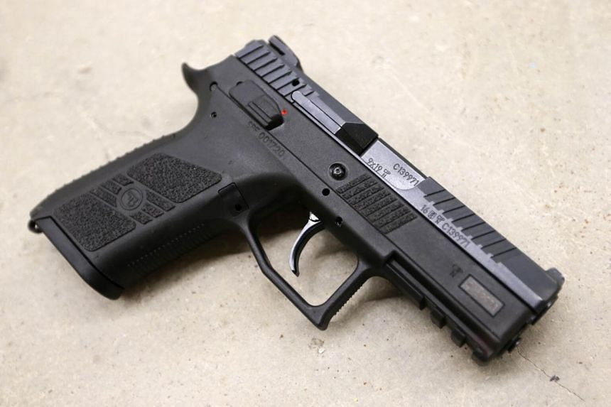 The officer told Taiwan's airport police that the pistol and six bullets were in her bag because of her negligence.