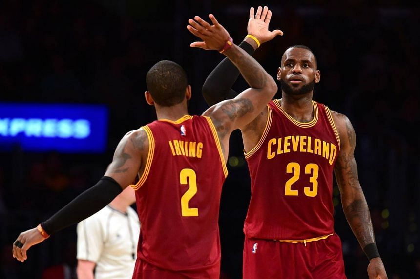 LeBron James #23 of the Cleveland Cavaliers celebrates his basket with a foul with Kyrie Irving #2 during a 125-120 win over the Los Angeles Lakers at Staples Center on March 19, 2017 in Los Angeles, California.