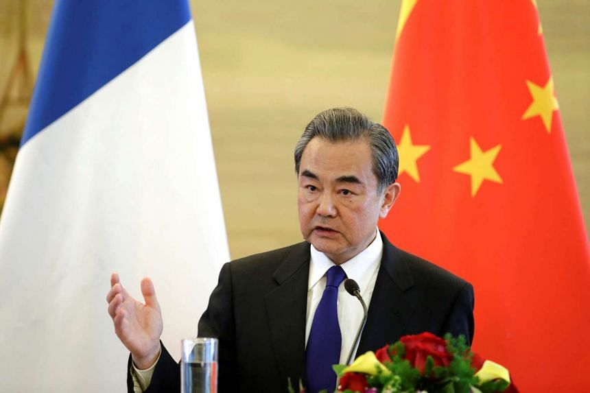 China's Foreign Minister Wang Yi at a news conference at the Ministry of Foreign Affairs in Beijing on April 14.