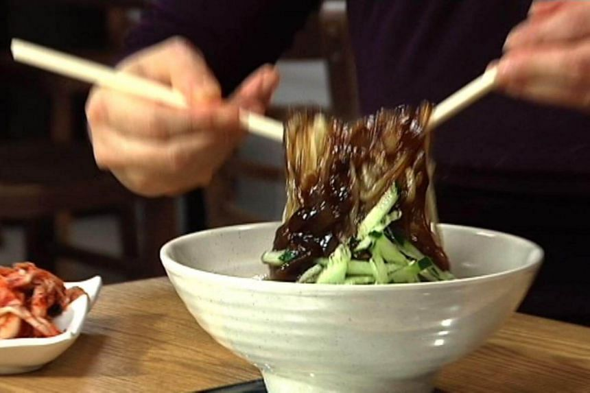 """Singles' Day is marked by eating """"jajangmyeon"""", a noodle dish topped with a thick sauce made of black beans."""