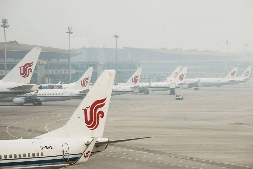Air China planes parked at Beijing Capital International Airport.