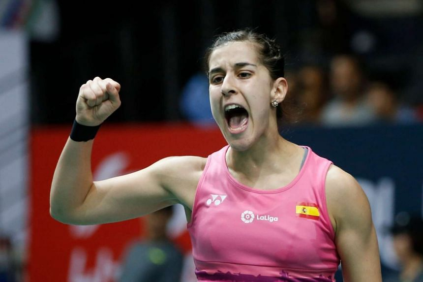 Carolina Marin celebrates her win against P.V. Sindhu during their Women's Singles quarter finals match of the OUE Singapore Open Badminton Tournament, on April 14, 2017.