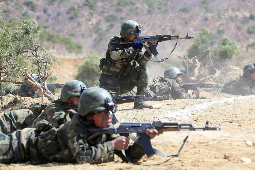 "The ""Dropping and Target-striking Contest of KPA Special Operation Forces - 2017"" at an undisclosed location in North Korea."