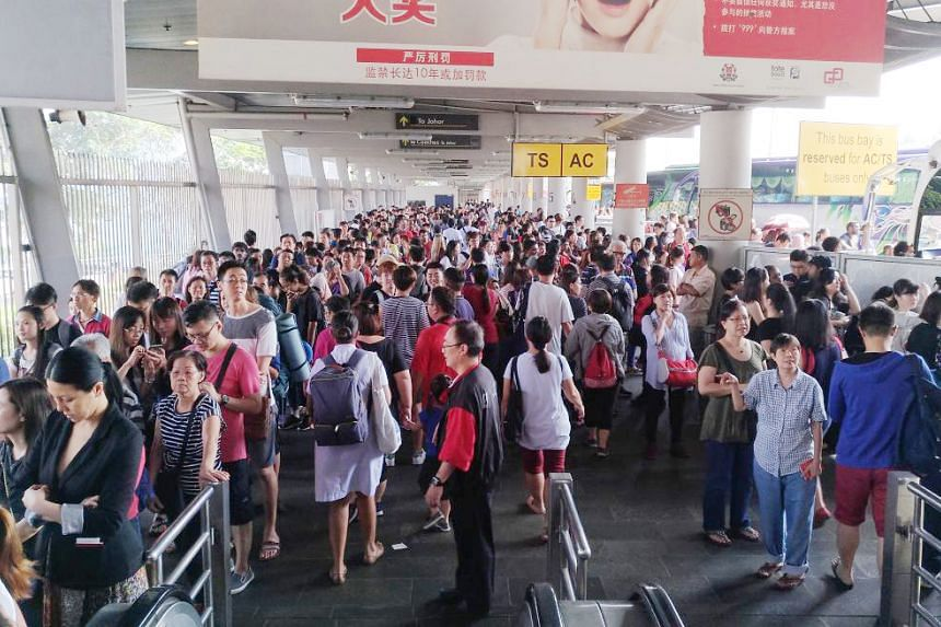 Crowds at the Customs at Woodlands Causeway on April 14, 2017.