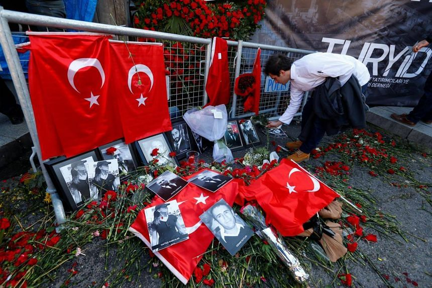 A man places flowers at the entrance of Reina nightclub, which was attacked by a gunman, in Istanbul, Turkey on Jan 3, 2017.