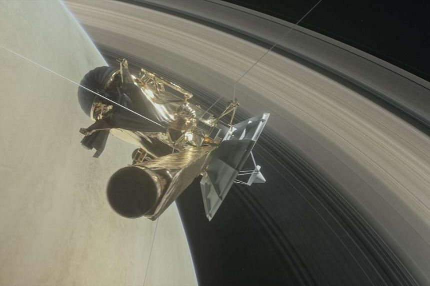 An illustration of Nasa's Cassini spacecraft about to make one of its dives between Saturn and its innermost rings.