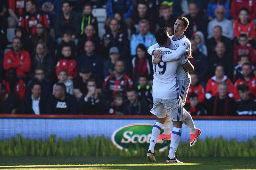 Chelsea's Eden Hazard (right) and teammate Diego Costa celebrate scoring their second goal during the match against Bournemouth on April 8.