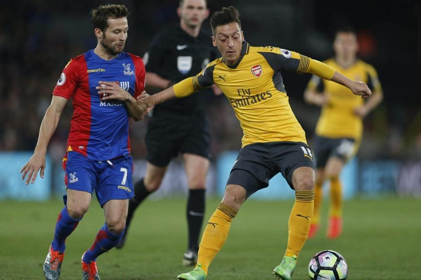 According to reports, Arsenal's Mesut Ozil (right) is refusing to sign a new deal of around £250,000 (S$437,000) per week.