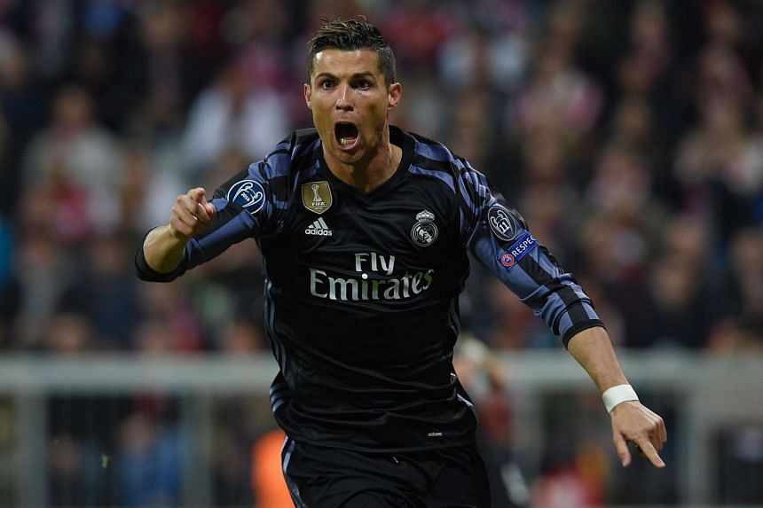 Real Madrid's Portuguese forward Cristiano Ronaldo celebrates after scoring during the UEFA Champions League 1st leg quarter-final football match in Munich, southern Germany on April 12, 2017.