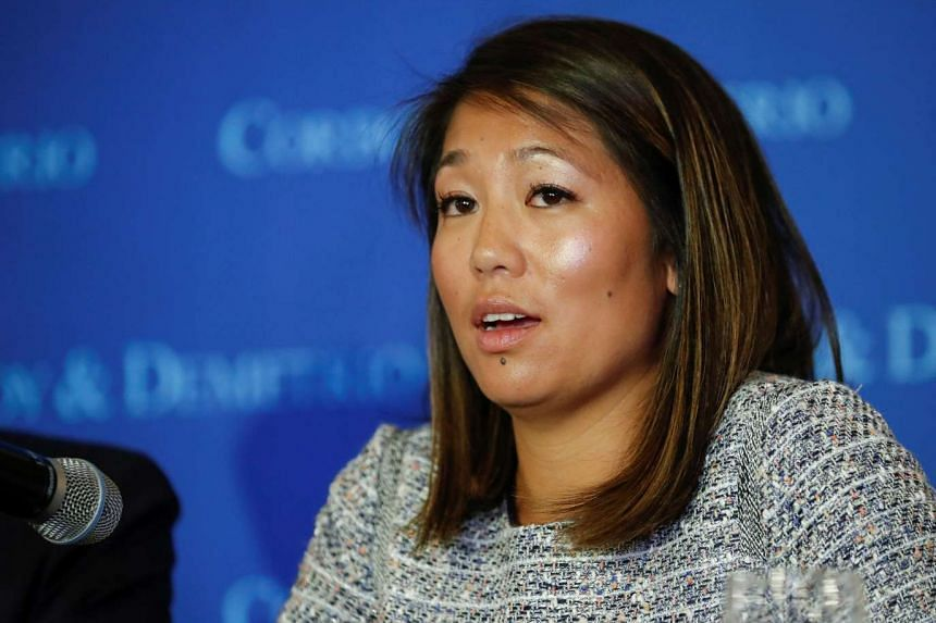 Crystal Dao Pepper, daughter of Dr. David Dao, speaks during the news conference.