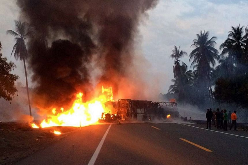 Two vehicles burn after a head-on collision on a highway in Mexico, April 13, 2017.