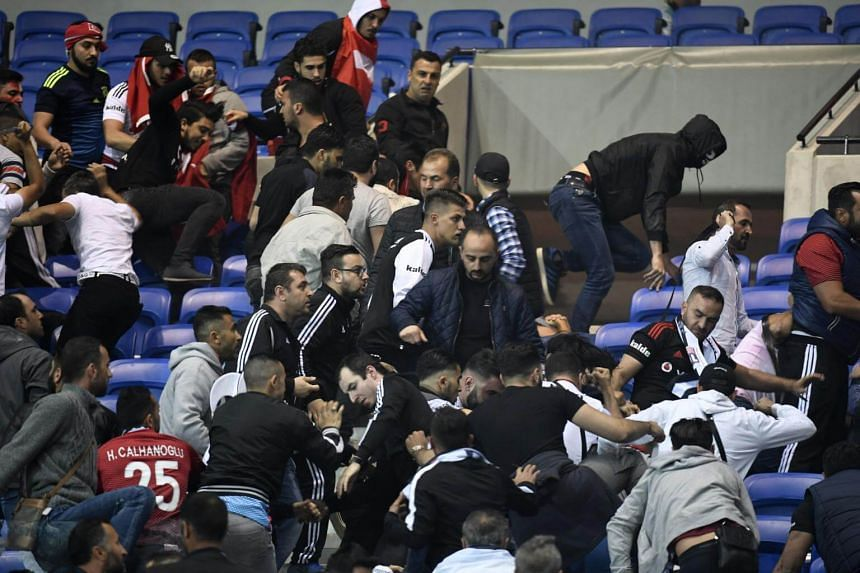 Besiktas' and Lyon's supporters fight before the Uefa match between both teams on April 13.