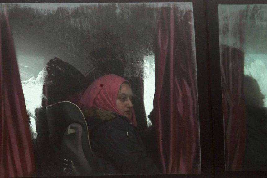 Residents being evacuated by buses from the two villages of Kefraya and al-Foua.